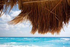 Beach umbrella and blue sea Stock Images