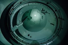 Inside unfinished reactor vessel of abandoned nuclear power plant. Bottom view of metal dome Stock Photo