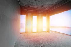 Unfinished room of seaside building under construction stock images