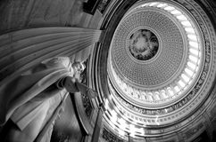 Inside US Capitol Dome. Inside of US Capitol Building with dome and statue of Abraham Lincoln holding document Stock Images