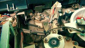 Inside Vhs Recorder: the mechanism stops working. This is footage of Inside Vhs Recorder: the mechanism stops working stock footage