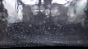 Inside view of an automatic car washing machine seen through window of car stock video footage