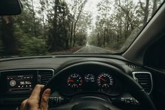 Inside view of car steering wheel while driving across Australian road. Royalty Free Stock Photo