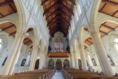 Inside view of a church with stained glass paint window Royalty Free Stock Photo