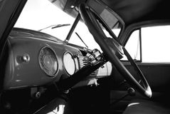 Inside view of classic truck. Black and white photo of a beautiful dash and steering wheel of an old classic truck Stock Photography