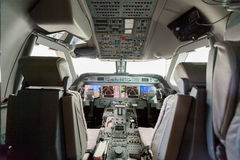 Inside view Cockpit G550. With blue sky and clouds Royalty Free Stock Photos