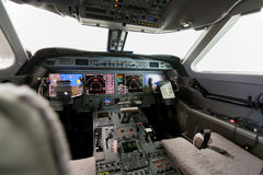 Inside view Cockpit G550. With blue sky and clouds Stock Image
