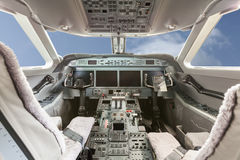 Inside view Cockpit G550 with blue sky and clouds. Aviation royalty free stock photos