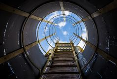 Inside view of a industrial stairs with blue sky in the end royalty free stock photography