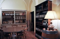 Local winery in the medieval town of Offida in central Italy. Inside view of local winery in the medieval town of Offida. Offida produces various types of fine royalty free stock image