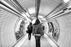 Inside view of the London underground. Inside view of the Underground Tube System.Travelers who go to the subway station in London Stock Images