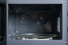 Inside view of microwave. Inside view of opened microwave with glass plate Royalty Free Stock Photography