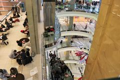 Inside view of a modern and large shopping center, composed of many floors. royalty free stock image