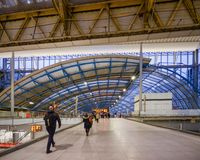 Inside view of passengers at Waterloo Station, one of London`s largest rail stations with impressive architecture stock photos