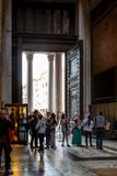 Inside view of people next to the big entrance door at the famous Pantheon building in Rome. royalty free stock images