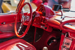 Inside View of Red Sports Car. Closeup view of the inside of an American Sports Car.  Red interior.  Red steering wheel and seats Stock Images