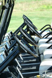Inside view of a row of golf carts Stock Image