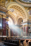 Inside view of St. Stephen's Basilica in Budapest lightened by dramatic sunshine. Stock Images