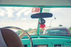 Inside a vintage classic american car in Old Havana. View from inside an old vintage classic american car in Havana, Cuba Royalty Free Stock Photography