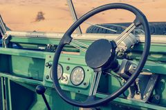 Inside of a vintage open top green 4x4 SUV stock photo
