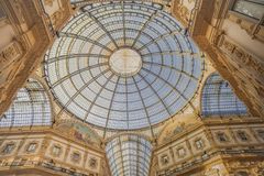 Inside the Vittorio Emanuele Gallery in Milan-Italy. The view of the top of Vittorio Emanuele Gallery from inside during the sunset of a sunny day royalty free stock photo