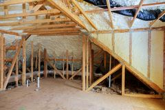 Inside wall heat isolation with mineral wool wooden house, building under construction. Inside wall heat isolation with mineral wool in wooden house, building Stock Photography