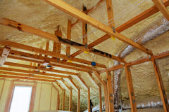 Inside wall insulation in wooden house, building under construction Royalty Free Stock Images