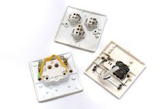 Inside a wall mount switch. Three opened wall mount switch panels. Royalty Free Stock Image