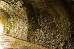 Inside wall of old railway tunnel Royalty Free Stock Photography