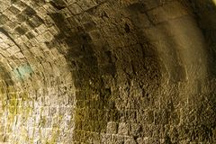 Inside wall of old railway tunnel Royalty Free Stock Photo