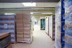 Inside of a Warehouse. Inside a warehouse, lots of box everywhere Stock Image