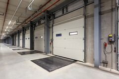 Inside of a warehouse with a row of loading bays