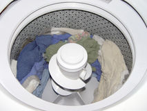 Inside Washer. Inside view of a clothes washer with clothes in it royalty free stock images