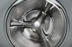 Inside washing machine. With detailed view at the metallic drum part Royalty Free Stock Photos