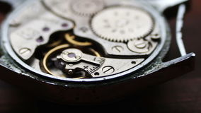 .Inside of watch mechanism On a stylish wooden background stock video