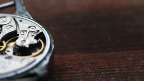 .Inside of watch mechanism On a stylish wooden background stock footage