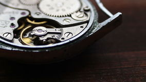 Inside of watch mechanism on a stylish wooden background stock video footage
