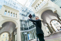 Inside the world of work. Businessman holding a laptop worth ove Royalty Free Stock Photography