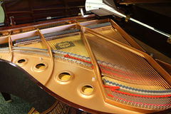 The inside of a Yamaha Grand Piano Stock Images