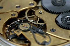 Insideof an old pocket watch. A macro shot of the inside of a pocket watch Royalty Free Stock Images