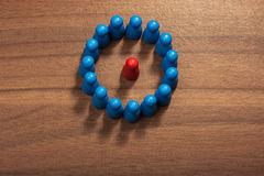 Insider, circle, figurine concept on wood table Royalty Free Stock Image