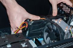 The insides of a computer in the hands of a technician stock images