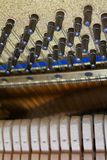 The insides of an old vintage piano details from the inside royalty free stock image