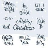 Insieme degli elementi dell'iscrizione della mano di Natale Agrifoglio gradevolmente Lasciate esso nevicare Gioia al mondo Buon N Fotografia Stock