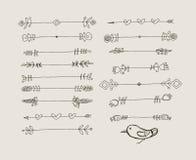 Insieme degli elementi neri disegnati a mano di progettazione di scarabocchio Immagini Stock