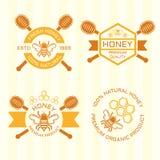 Insieme degli emblemi color miele di vettore royalty illustrazione gratis