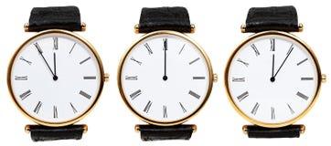 Insieme degli orologi con tempo di mezzanotte fotografia stock
