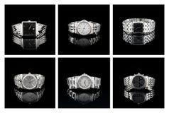 Insieme degli orologi dello svizzero con i cinturini di orologio del metallo sul nero Fotografia Stock