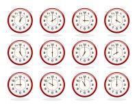Insieme degli orologi rossi per gli orari di esercizio Fotografia Stock Libera da Diritti