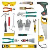 Insieme degli strumenti della costruzione isolati su un fondo bianco Livelli, sega, i vetri, la misura di nastro, la chiave, la c Fotografia Stock